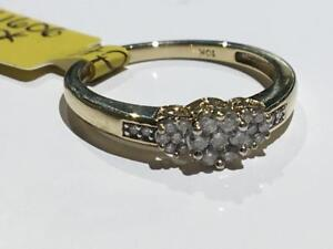 #128 10K YELLOW GOLD ILLUSION SET DIAMONDS TOTALING 1/4 CT *SIZE 7* APPRAISED FOR $1350.00 SELLING FOR $495!