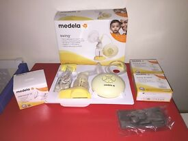 Medela Swing Electric breast pump with brand new unopened bags