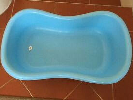 Baby blue bath with plug for easy water drainage
