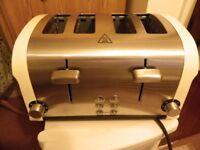 Four slice cream and chrome toaster
