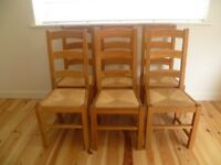 six ladder back solid oak dining chairs