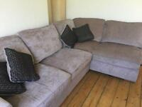 Corner sofa with pouffe