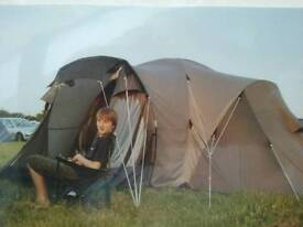 Canterra 4 Tent, sleeps 4 in the bedroom sections, could squeeze in 2 more!