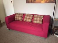 Ikea sofa with red and black covers