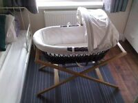 Moses basket with stand and spare sheets