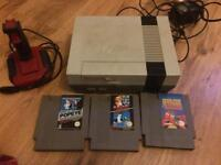 Nes console and three great games
