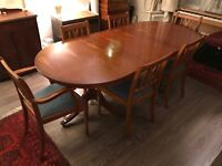 Beautiful yew veneer dining table with four chairs and two carvers