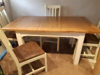 Solid oak top extendable dinning table & 4 distressed leather chairs