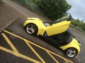 Beautiful convertible yellow roadster collectors item
