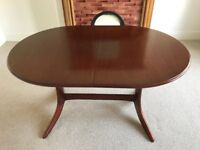 'Nathan' oval mahogany dining table. Extends to sit 6. Excellent condition. 4 matching chairs extra.