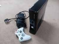 XBOX 360s complete with one controller & games