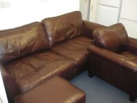 BROWN LEATHER SOFA, CHAIR AND POUFFEE at Haven Housing Trust's charity shop