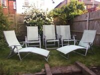 Garden table, parasol, 6 chairs (all recliners) and 2 sun loungers.