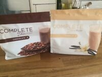 2 unopened packets of Juice Plus shakes, chocolate and Vanilla
