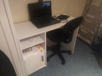 White desk and black chair