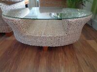 Glass top wicker coffee table