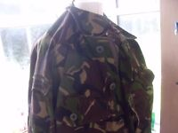 LARGE AMOUNT ARMY COMBAT GEAR 3 JACKETS .2 CAPS , TROUSERS & SURVIVAL BAG HAS CHEMICAL AGENT PAPER