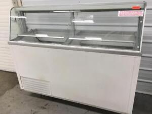 Hussmann 12 Tub Ice Cream Dipping Cabinet w Baskets, Dividers, and Sneeze Guard.