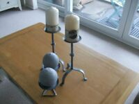 FOUR CANDLESTICKS WITH NEW CANDLES