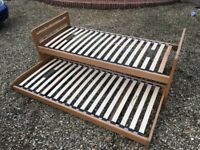 Wooden Roll Out Single bed.