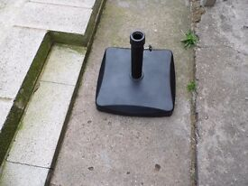 black concrete base for umbrella with support pole and fixings £12. o.n.o.