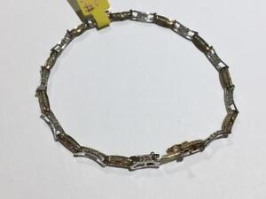 #1627 10K YELLOW AND WHITE GOLD DIAMOND BRACELET WITH BOX CLASP 7 3/4 IN LENGTH. APPRAISED FOR $1950.00 SELL FOR $525.00