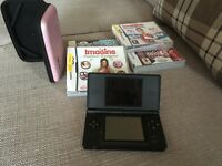 Nintendo with pink case, game card and additional boxed games