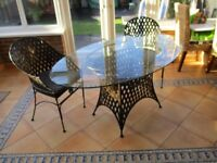 Oval Glass & Steel dinning table 1500 x 800mm & two carver chairs