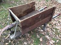 Vintage timber wheelbarrow with solid metal wheel