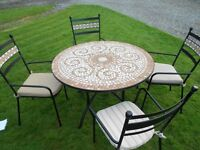 A Large New Ceramic Table With Matching Chairs