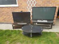 Free if gone today !!!Spares or rapair project Tv 2x and 2 tv stand and coffee table