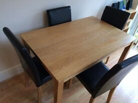 Wooden Dining Table with 4 Black Faux Leather Chairs