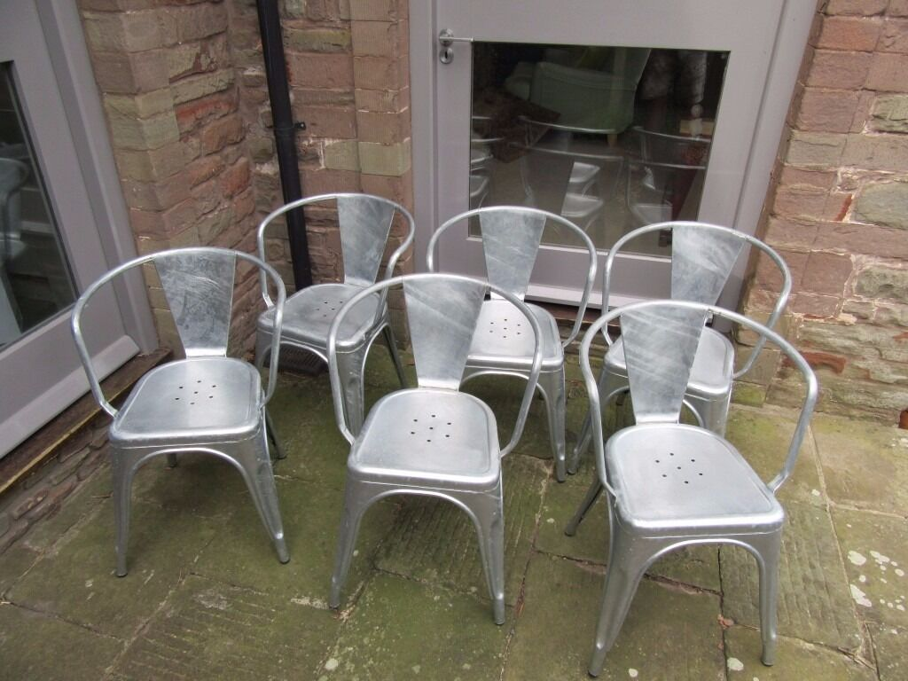 DINING CHAIRS metal bistro styleSet of 6in Downend, BristolGumtree - Habitat dining chairs. Classic retro style with arms. Industrial zinc galvanized, finished with gloss lacquer. High stacking capacity, non scratching rubber feet. Only ever used as occasional indoor dining chairs. Full set of 6 chairs £150 or £25...