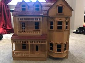 Dolls house with furniture and dolls.
