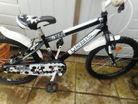 boys black and white 20 inch wheel oris bike