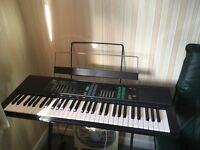 Yamaha portable keyboard. PSR-36 model also with chair ,manual and a variety of music books .