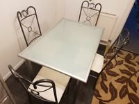 Dining table with four matching chairs