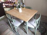 table and 4 chairs ,pine top ,painted base and chairs