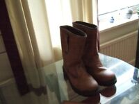 pair of mens rigger boots and a boxed combination set