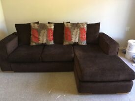 Used Fabric Sofa. Brown and red, 4 seater lounger with 5 cushions