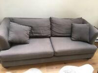 Comfortable three seater grey sofa for sale (two years old)