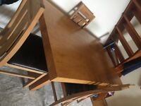 Lovely solid oak table for sale with 4 matching chairs