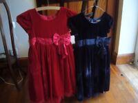 Two girls' velvet dresses aged 7