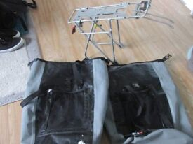 large bycycle pannier rack with pannier bags,easily holds camping gear for 1/2,bags hook onto frame.