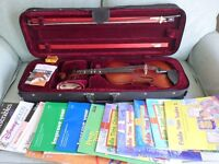 Loreato 4/4 violin with case and a range of music for grades 1 and 2