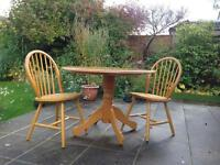 3ft6 Round pine table and four matching chairs.