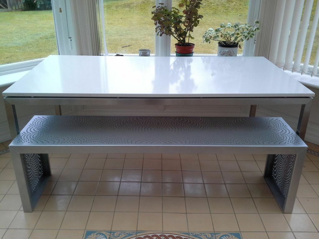 Contemporary stone dining table - Contemporary Caesar Stone And Metal Dining Table With Laser Cut Aluminium Benches