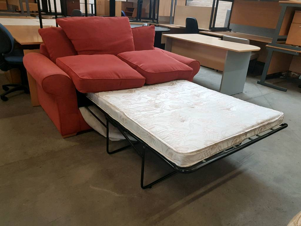 Red fabric 2 seater sofa with metal fold out bed