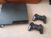 Playstation 3 with 2 remote controls
