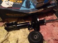 CORSA C NEW FRONT STRUT AND TOP MOUNT
